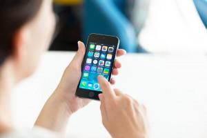 bigstock-Woman-Using-Apple-Iphone-S-smartphone-line-sns