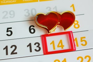 Date February 14 marked on the calendar. Two hearts the concept