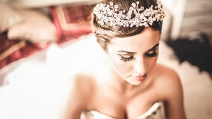 Gorgeous bride portrait in her wedding dress wearing tiara. Beau