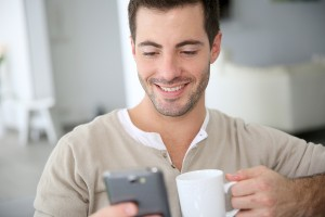 Man at home connected on smartphone