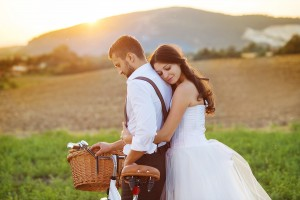 Bride and groom with a white wedding bike