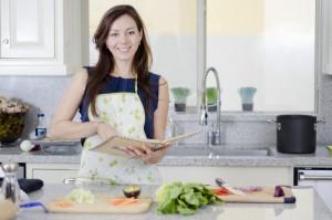 Cute housewife making dinner