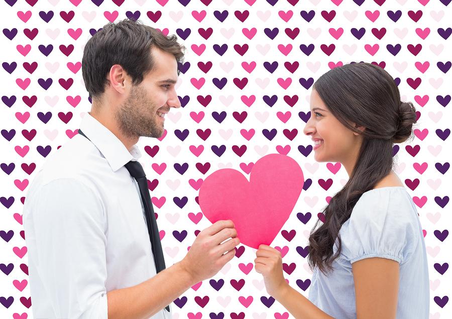 Pretty brunette giving boyfriend her heart against valentines da