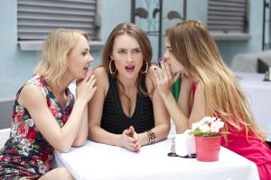 Three beautiful girlfriends gossiping woman sitting in the summe