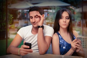 Secretive Couple with Smart Phones in Their Hands
