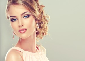 Beautiful model with  elegant hairstyle . Beautiful woman with f