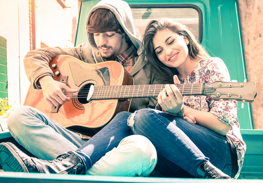 Romantic Couple Of Lovers Playing Guitar On Old Fashioned Mini C