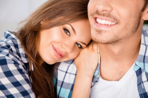 Closeup Photo Of Happy Girl Huging Her Smiling Boyfriend